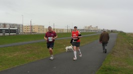 Running with Mike. He really helped me settle into the race!